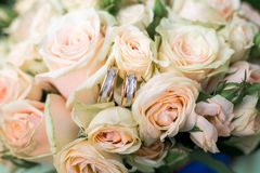 Wedding rings on wedding bouquet. Beautiful wedding rings on wedding bouquet outdoors Royalty Free Stock Photo
