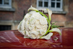 The wedding rings and a bouquet of the bride Royalty Free Stock Image