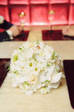 Wedding Rings on Bouquet at Cafe Royalty Free Stock Images