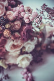 Wedding rings on a bouquet of colorful flowers. With berries stock photos