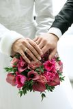 Wedding rings on bouquet of flowers.  Stock Images