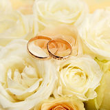wedding rings on a bouquet of flowers for the bride Royalty Free Stock Photography