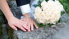 Wedding, rings and bouquet Stock Photos