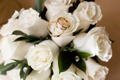 Wedding rings on a bouquet of flowers stock photography
