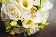 Wedding rings on the bouquet Stock Photo