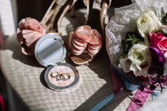 Wedding rings, a bouquet of lavender and beige bridesmaid shoes Royalty Free Stock Photo