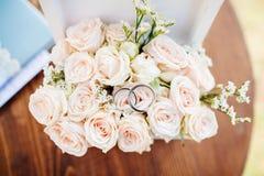 Wedding rings on bouquet macro Stock Photos