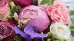 Wedding rings on bouquet, macro, horizontal Royalty Free Stock Images