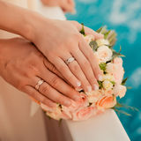 Wedding rings with bouquet. Near the sea Stock Photos