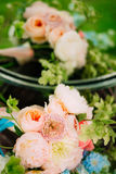 Wedding rings on a bouquet of peonies Royalty Free Stock Photos