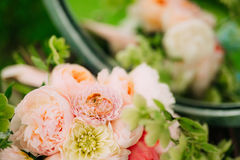 Wedding rings on a bouquet of peonies Stock Photos