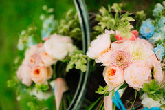 Wedding rings on a bouquet of peonies Stock Image