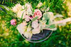 Wedding rings on a bouquet of peonies Royalty Free Stock Photography