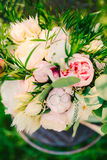 Wedding rings on a bouquet of peonies Royalty Free Stock Image