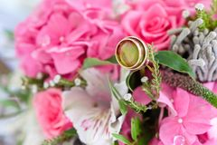Wedding rings in the bouquet of pink flowers. Wedding rings in the bouquet of pink flowers Royalty Free Stock Photography
