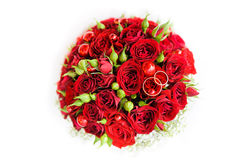 Wedding rings on a bouquet of roses. Golden rings on a wedding bouquet of roses Royalty Free Stock Photos