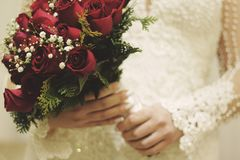 Wedding rings and bouquet of roses royalty free stock image