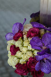 Wedding rings on a bouquet of roses and orchid Stock Photo