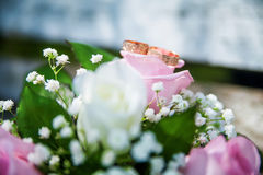 Wedding rings and bouquet on the table Stock Image