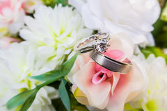 Wedding rings on bouquet. Two wedding rings on bouquet of flowers Royalty Free Stock Image