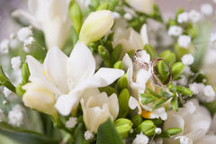 Wedding rings in a bouquet Royalty Free Stock Images