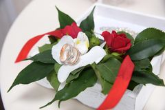 Wedding rings in a bouquet of flowers. Wedding rings in a bouquet of white flowers Stock Images