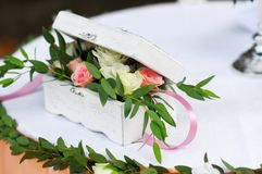 Wedding rings in a bouquet of flowers. Wedding rings in a bouquet of white flowers Stock Image