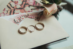 Wedding rings with boutonniere Stock Photo