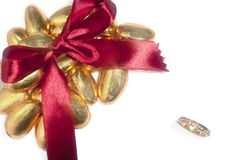 Wedding rings and bow Royalty Free Stock Images