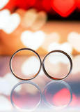 Wedding rings with box in the background Royalty Free Stock Image