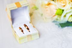 Wedding rings in box with bouquet Royalty Free Stock Images