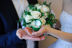 Wedding rings in a box on the bouquet. Stock Images