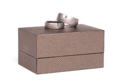 Wedding rings on box. Wedding rings on a box, isolated on white background stock photo