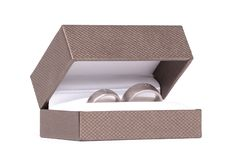 Wedding rings in box. Isolated on white background royalty free stock photo