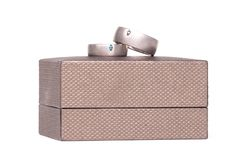 Wedding rings on box. Wedding rings on a box,  on white background royalty free stock image