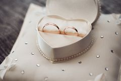 Wedding rings are in a box in the shape of a heart royalty free stock image