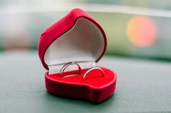 Wedding rings in a box in the shape of a heart. Two wedding rings in a box in the shape of a heart. Horizontal frame stock photo