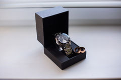 Wedding rings on a box of watches, wrist watches, pocket watches, Royalty Free Stock Images
