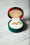 Wedding rings. In the box on the wooden background Royalty Free Stock Photography