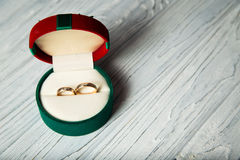 Wedding rings. In the box on the wooden background Stock Photos