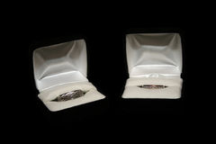 Wedding Rings and Boxes. Wedding rings displayed in open ring boxes on a black background Royalty Free Stock Photos