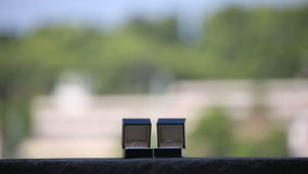 Wedding rings in the boxes on the balcony on a background of an exotic city stock footage