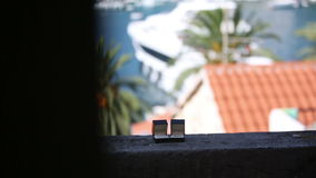 Wedding rings in the boxes on the balcony on a background of an exotic city stock video footage