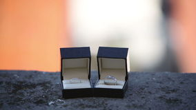 Wedding rings in the boxes on the balcony on a background of an exotic city stock video