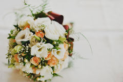 Wedding rings on bridal boquet Stock Images