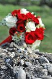 Wedding rings and bridal bouquet Royalty Free Stock Photography