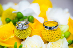 Wedding Rings on Bridal Bouquet Stock Images
