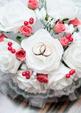 Wedding rings on the bridal bouquet Stock Photo