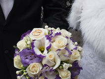 Wedding rings on a bridal bouquet Stock Photo