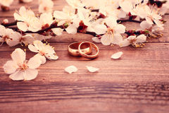Wedding rings. Bridal bouquet of white flowers stock photo